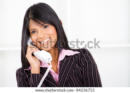 beautiful businesswoman on phone - stock photo