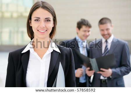 Beautiful businesswoman on the background of business people - stock photo