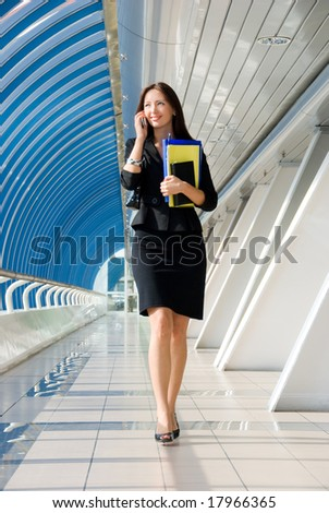 Beautiful businesswoman on the phone in a modern business center - stock photo