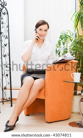 Beautiful businesswoman on the phone, isolated on white - stock photo