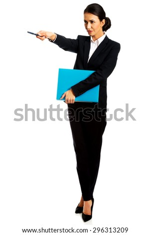 Beautiful businesswoman pointing by pen - stock photo