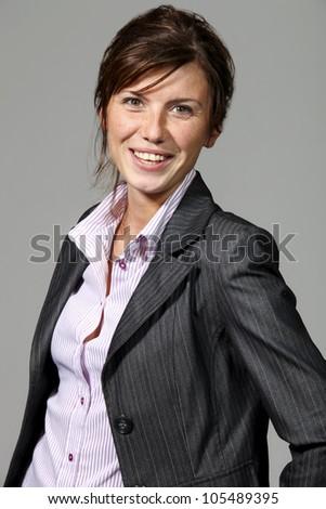 beautiful businesswoman portrait, gray background - stock photo