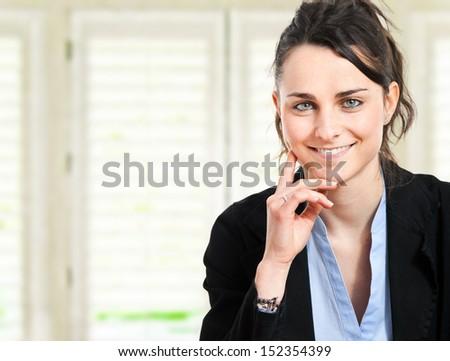 Beautiful businesswoman portrait in her office - stock photo