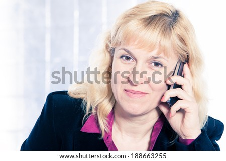 Beautiful businesswoman portrait with mobile phone - stock photo
