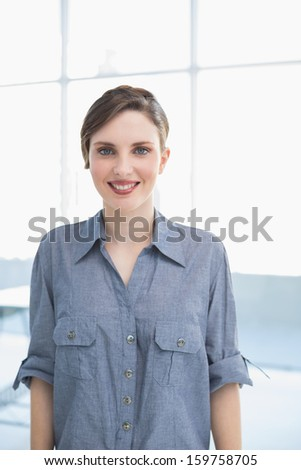 Beautiful businesswoman posing in office smiling at camera