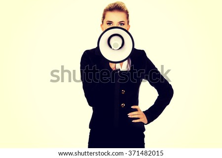 Beautiful businesswoman shouting with megaphone