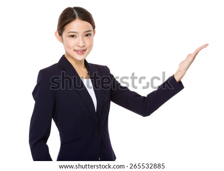 Beautiful businesswoman showing - stock photo