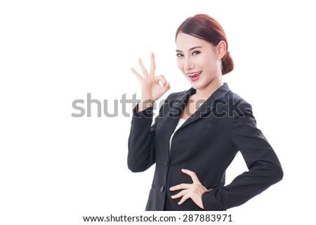 Beautiful businesswoman showing ok sign on white background - stock photo