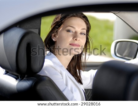 beautiful businesswoman siting in the premium car - stock photo