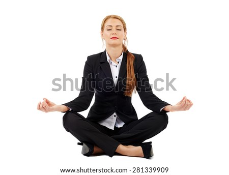 Beautiful businesswoman sitting in lotus position of yoga, isolated on white