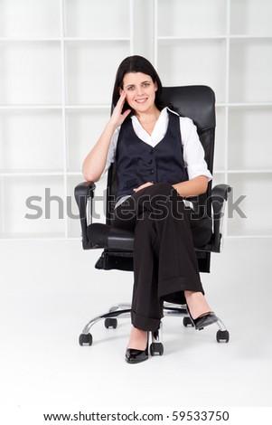 beautiful businesswoman sitting in office - stock photo