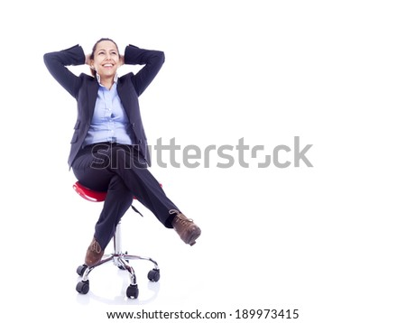 Beautiful businesswoman sitting on a chair, isolated on white - stock photo