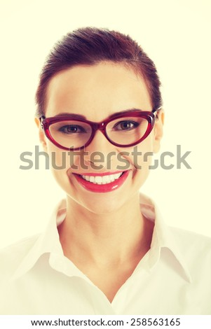 Beautiful businesswoman smiling to camera.