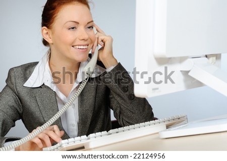 Beautiful businesswoman smiling while talking on telephone - stock photo