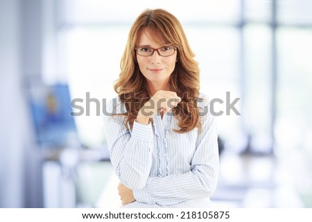 Beautiful businesswoman standing at office. Business people.  - stock photo