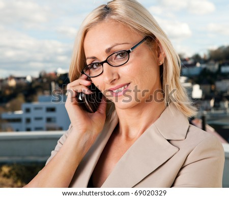Beautiful businesswoman talking on cellphone