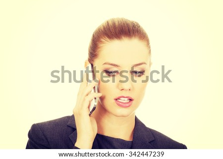 Beautiful businesswoman talking on mobile phone. - stock photo