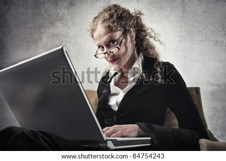 Beautiful businesswoman using a laptop - stock photo