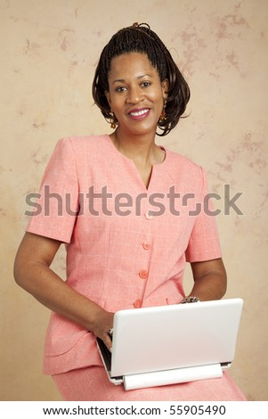 Beautiful businesswoman using a small, 3G netbook computer.