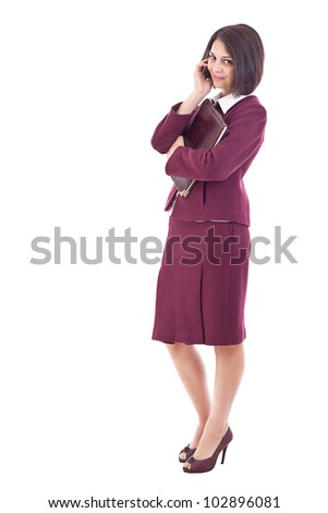 Beautiful businesswoman with books isolated on white background - stock photo