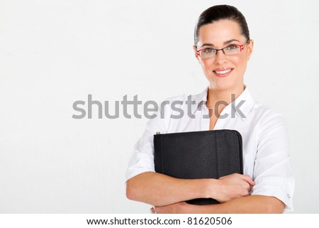 beautiful businesswoman with briefcase studio portrait - stock photo