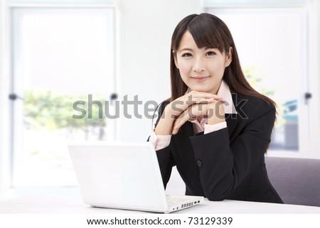 Beautiful businesswoman with laptop - stock photo
