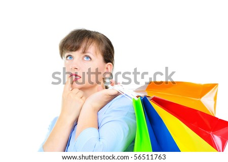Beautiful businesswoman with shopping bags - stock photo