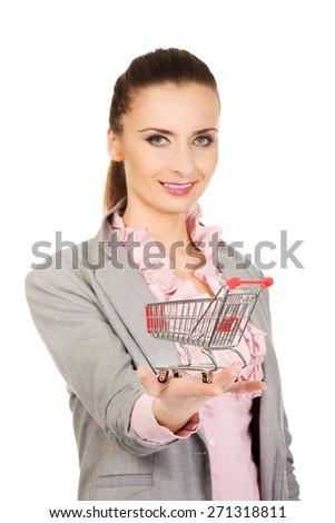 Beautiful businesswoman with shopping cart. - stock photo