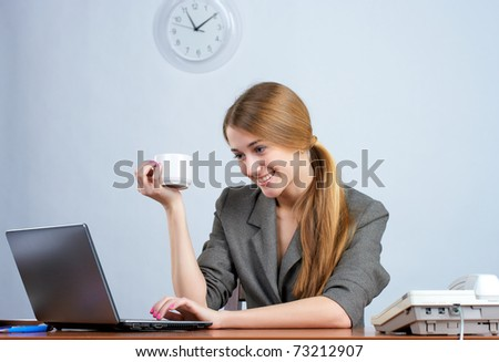 Beautiful businesswoman working on laptop in the office - stock photo