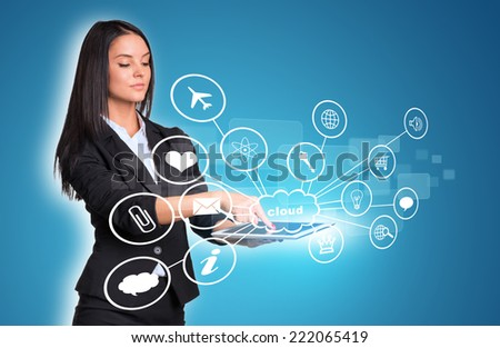 Beautiful businesswomen in suit using digital tablet. Cloud with icons. Blue background - stock photo