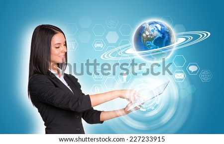 Beautiful businesswomen in suit using digital tablet. Earth and hexagons with icons. Element of this image furnished by NASA - stock photo