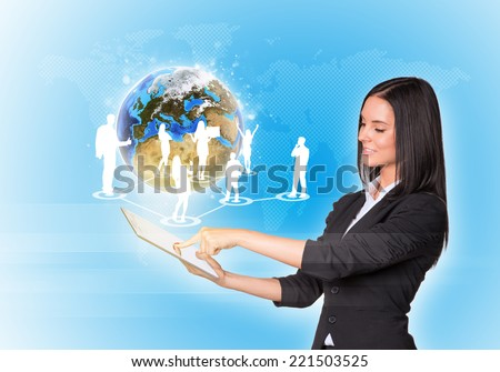 Beautiful businesswomen in suit using digital tablet. Earth with silhouettes of business people. Element of this image furnished by NASA - stock photo