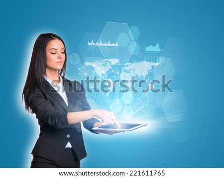 Beautiful businesswomen in suit using digital tablet. World map, transparent hexagons, graphs and network - stock photo