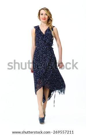 Beautiful Busyness Woman  Fashion Model in summer long spotted dress