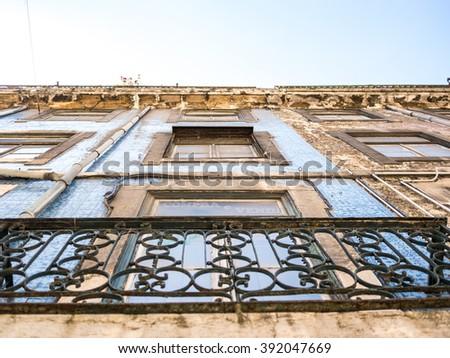 Beautiful but old Lisbon facades - stock photo