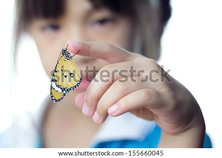 Beautiful butterfly sitting on the girl hand  - stock photo