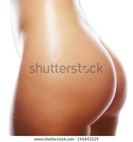 Beautiful buttocks of a nude woman. Close up.Isolated on white.  - stock photo