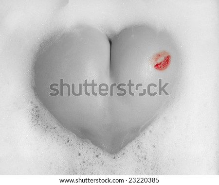 beautiful buttocks of a young woman in white foam - stock photo