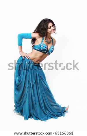 Beautiful cabaret woman in blue oriental dancer's dress. Show girl in bright bra and skirt isolated on white background. - stock photo