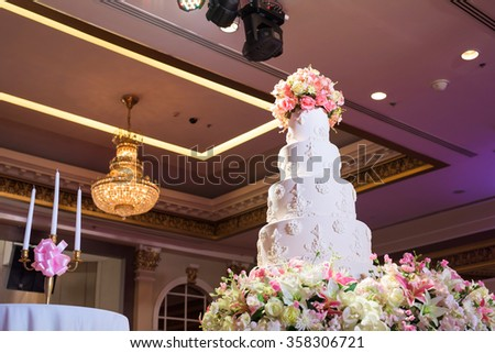 Beautiful cake and candles decorated for wedding party - stock photo