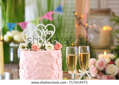 Beautiful Cake For Lesbian Wedding Decorated With Flowers In The Room