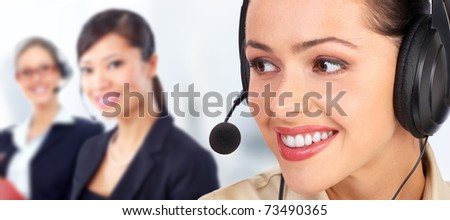 Beautiful  call center operator with headset. Over blue background .