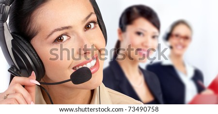 Beautiful  call center operator with headset. Over blue background . - stock photo
