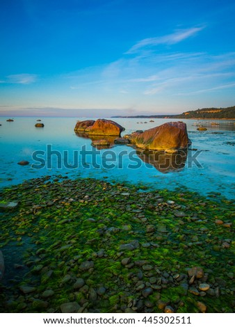 Beautiful calm seascape during magnificent sunset. Toila, Estonia. - stock photo