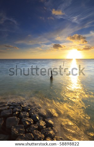 Beautiful calm sunset at the ocean in summer