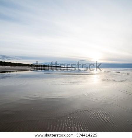 Beautiful calm sunset over the sea. Sunrise in the sea. - stock photo