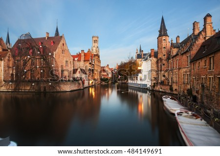 Beautiful canal and famous Belfry in Bruges (Brugge), Flanders, Belgium.