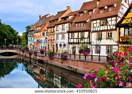 Beautiful canals of Colmar, France with late day reflections - stock photo
