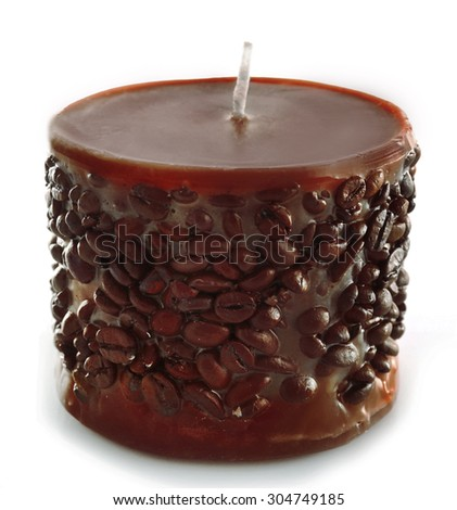 Beautiful candle with coffee grains, isolated on white - stock photo