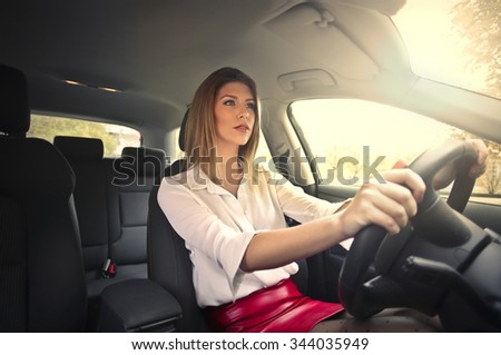 Beautiful car driver - stock photo